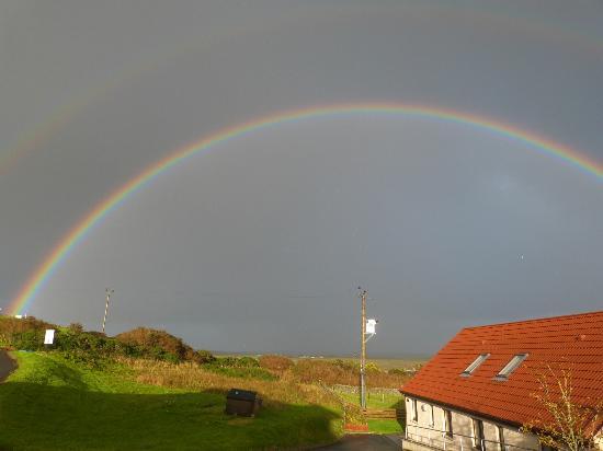 Scapa Flow Lodges: Rainbow over Cava Lodge