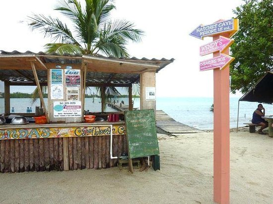Brenda's BBQ: Brenda's stand in Placencia - that's Brenda in the shade on the right