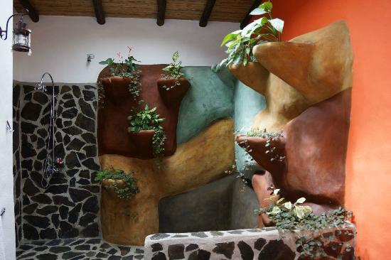 Hotel Mountain Paradise: Bad mit Wasserfalldusche in der Master Suite