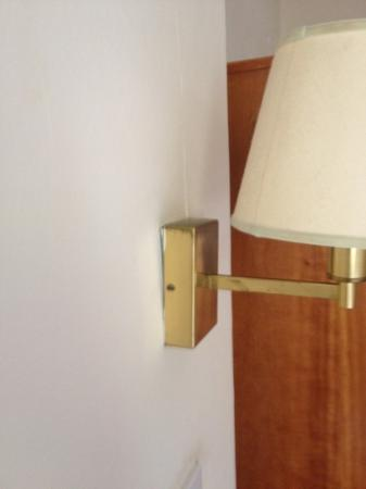 Dreadnought Hotel: wall light pulling off the wall in room 226