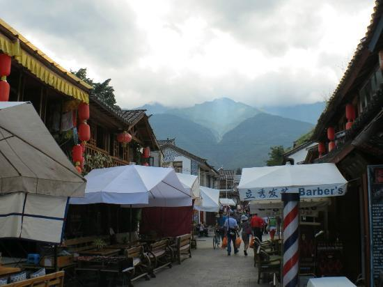 YunNan Coffee Ba: Yunnan Cafe on the left with the two white awnings