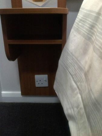 Premier Inn London Twickenham East Hotel: Socket next to bed