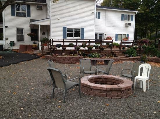 Moore's Motel: fire pit & office