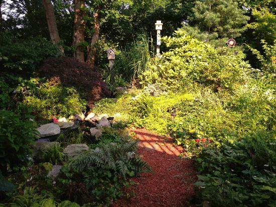 Sheppard's Place: Gardens with chickens and fish pond