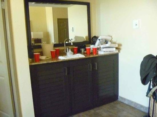 Embassy Suites by Hilton Mandalay Beach Resort: the bar area, um, messy from use, w/ fridge and microwave!