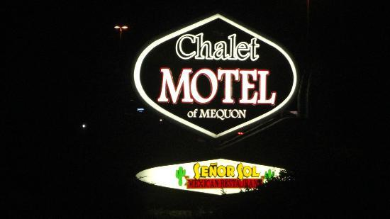 Chalet Motel Of Mequon: The motel sign lit at night