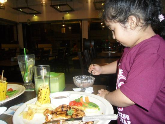 Texas Grill restaurant and bar: My daughter enjoying her foods