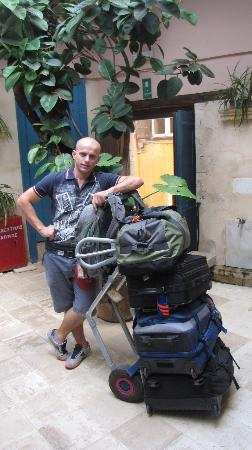 Amphora Hotel: After check-out, Augostin taking our bags back to the car
