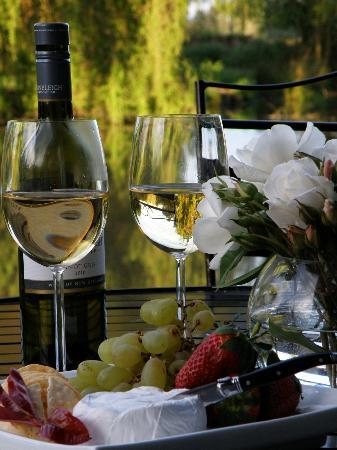 Revive on Oakview: Relax with a glass of wine on the deck overlooking the pond