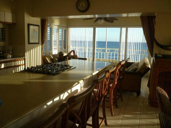 Waikiki Shore: Kitchen island and 'pseudo bedroom' with two futons.