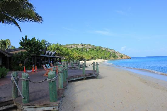 Galley Bay Resort: View from front of bar area up beach past Seagrape restaurant to Ganguin restaurant at end of be