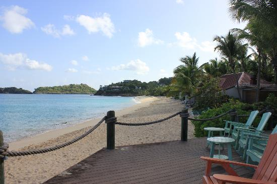 Galley Bay Resort: View from front of bar area looking down beach past water sports to Ismay restaurant end