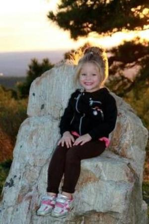 High Point State Park: Vivi found a rock with a seat at the top of the mountain.