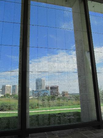 Virginia War Memorial: Skyline of Richmond seen through names etched into glass wall