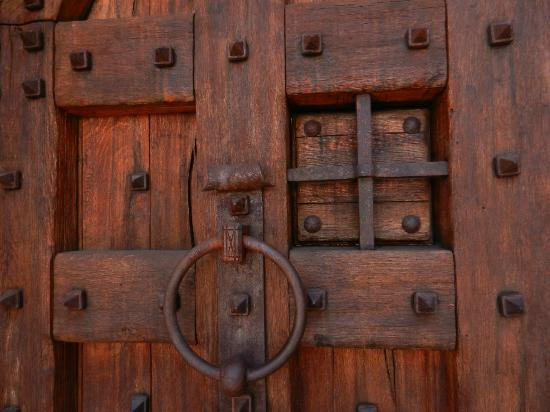 Castello di Amorosa: One of the beautiful handmade doors with ironwork.