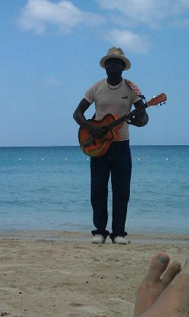 Sunset at the Palms: Many live music opportunities on the beach.  Some better than others.  This guy was pretty good!