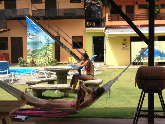 El Faro Beach Hostel: Relaxing by our hammocks!!!