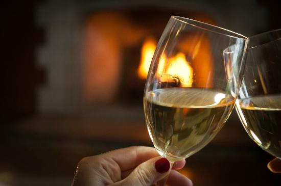 Palmer House Inn: Romantic glass of wine by the fire.