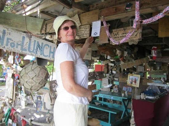 Pineapple Beach Club Antigua: Pinning up our sign at the Outhouse