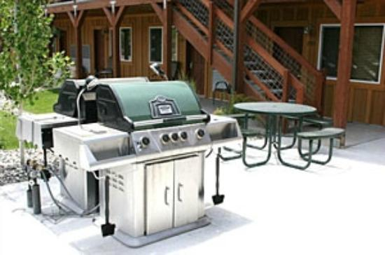 Centennial Suites: Become the grillmaster at one of our many gas barbeque grills on the property