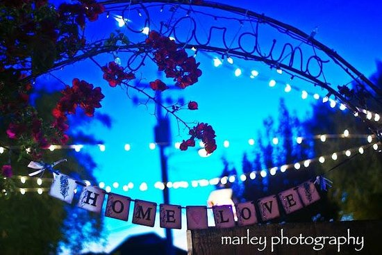 Giuseppe's Cucina Italiana : Garden sign with strings of lights in the background