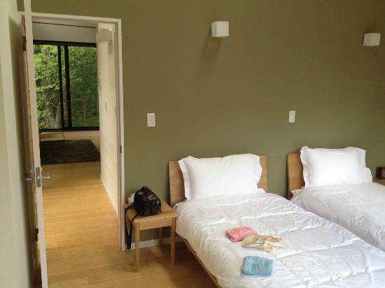 Gakuto Villas: Second-floor twin bedroom and hallway to living/dining room and kitchen