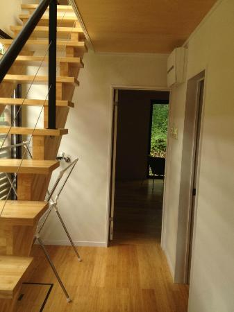 Gakuto Villas: First-floor stairs and hallway leading to double bedroom