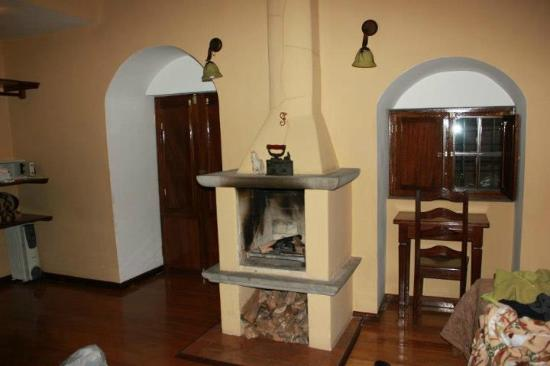Andenes al Cielo: comfy room with fireplace
