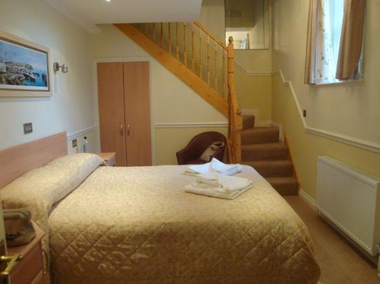 The Pier House Hotel: A refurbished family room with stairs up to single bed and ensuite bathroom