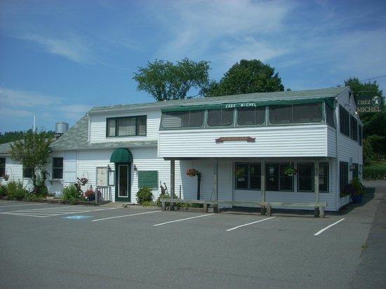 Chez Michel Restaurant: The parking lot entrance at Chez Michel
