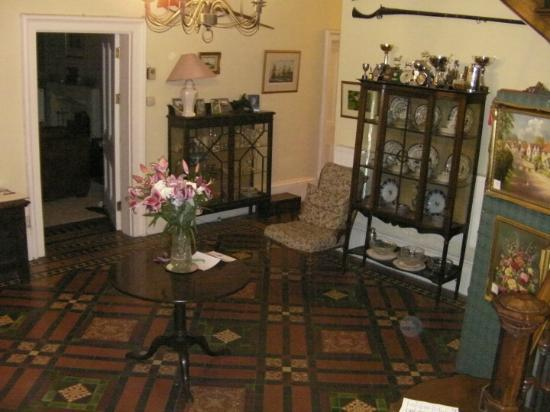 The Old Rectory: View of entrance hallway displaying historical collections.