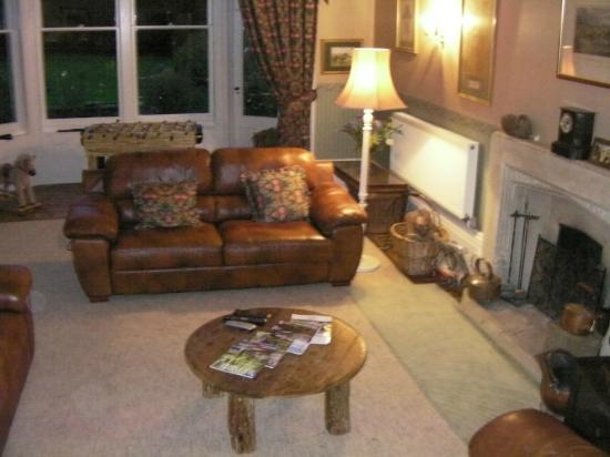 The Old Rectory: View of resident's lounge towards gardens at night.