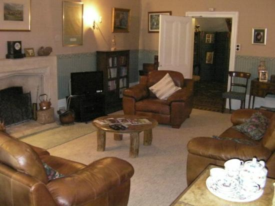 The Old Rectory: Evening view of resident's lounge looking towards entrance hallway.