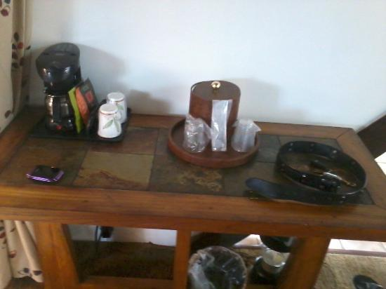 Timber Cove Inn: Little counter with coffee & condiments, ice bucket, and lantern in case of power outages.