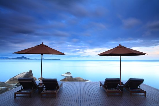 The Kala Samui : panoramic sea view with some book..