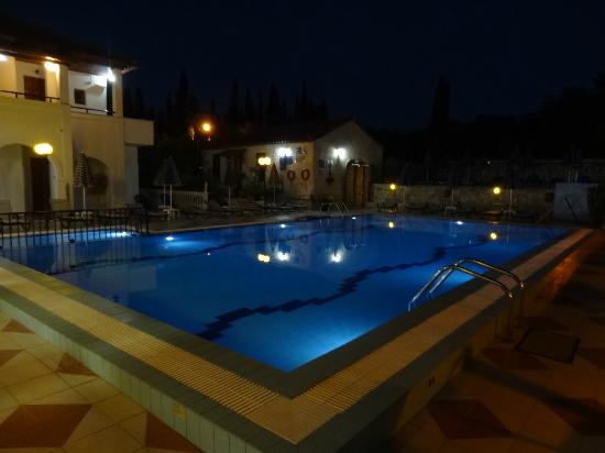 Potamitis Studios: The pool at night - our room at far end on ground floor