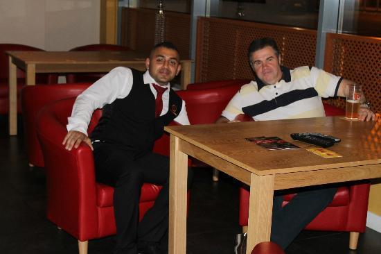 Bombay Brasserie: Staff and Customers enjoying the bar