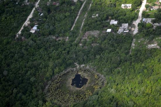 Chichen itza By Airplane: Some cenote near Cancun