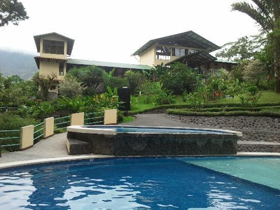 Arenal Observatory Lodge & Spa: Pool area and nearby accommodation