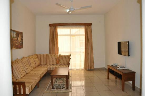 Nesma Homes: Living room, suite wing