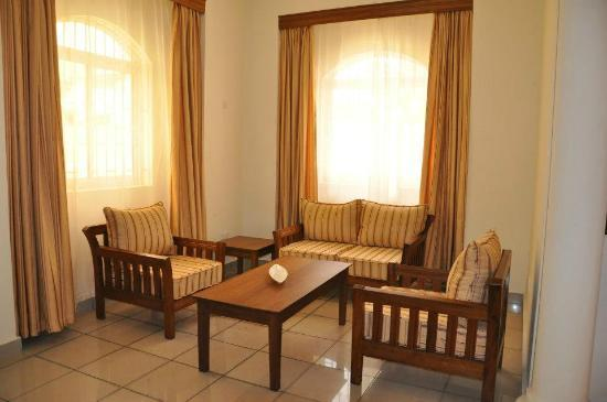 Nesma Homes: Living room area, suites wing