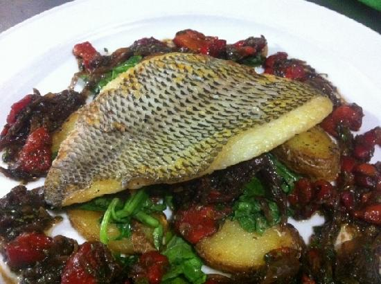 Essence Brasserie: Fillet of seabass, sauteed potatoes & rocket with red pepper, caper & caramelised onion vinaigre