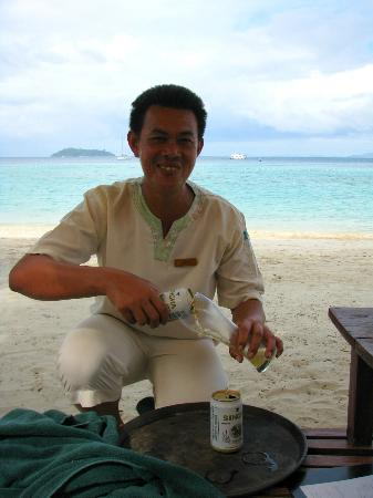 Zeavola Resort: Kong - he reserved our beach beds daily for us and served drinks