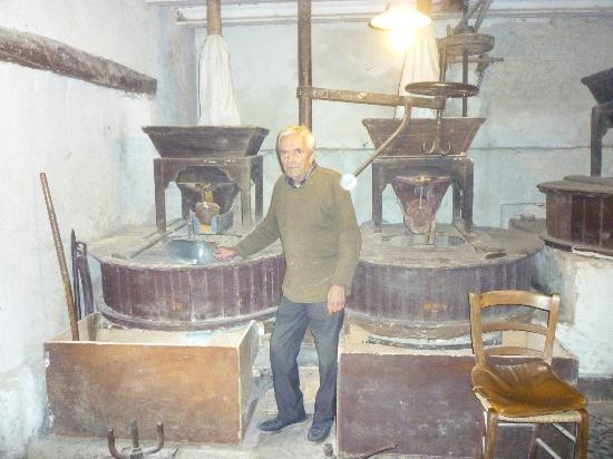 Mulino ad Acqua: The interior of the mill, with the miller himself - a very welcoming man.