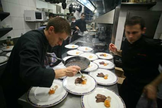 Windsor: Cheff Carlos Alconchel finishing meat dishes
