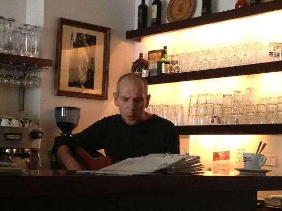 Primaria : Bartender playing his guitar for us.