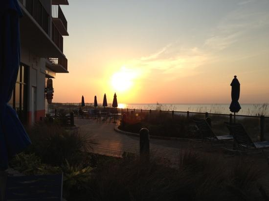 Hampton Inn & Suites Orange Beach: sunrise while eating breakfast on back patio.