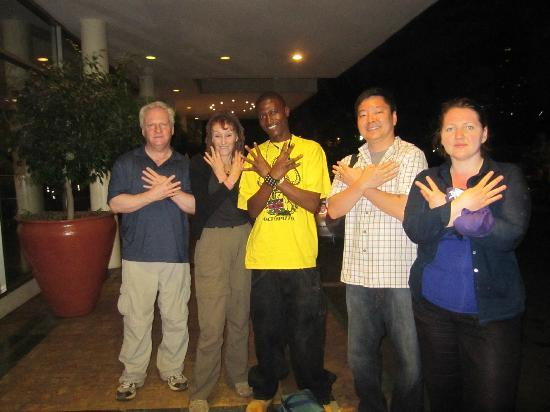 "Kibera: Four of us doing the ""Octo"" sign after he dropped us back at our hotel in Nairobi."