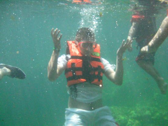 Sandos Caracol Eco Resort: my son in the cenote