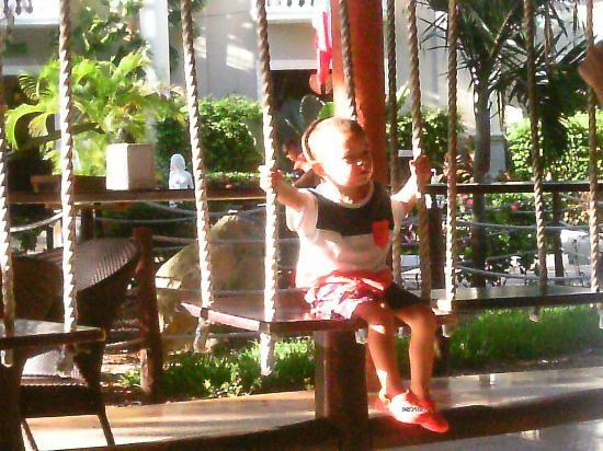 Sandos Caracol Eco Resort: my grandson Alfie loving the swing seats at el nido